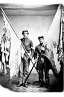 Sergeant John Lyon and Corporal Melvin Tucker with flags from the 16th New York, ca. 1865