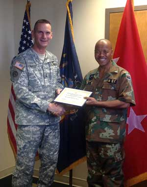 NY SPP - MG Patrick Murphy presents AG Award to MG Mogoruti Ledwaba during JFHQ visit 2012