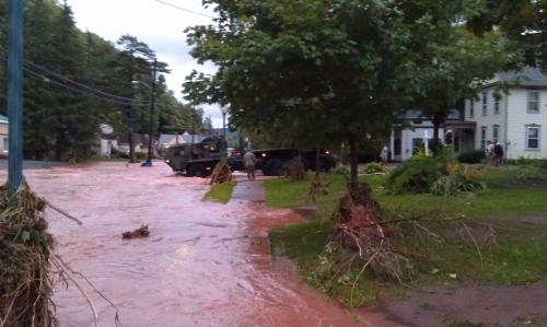 New York Army National Guard Engineer Soldiers Walk Through the Flood to Rescue Residents