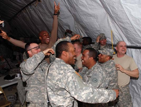Guard Soldiers celebrate Giants victory during Super Bowl 42 at Ft Bragg, NC
