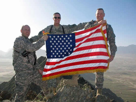 Soldiers from the 27 Brigade Combat Team climb Ghar Mountain in Afghanistan.
