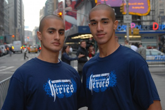 The Rios brothers pose before Jospeh Rios (right) reaffirms his oath of enlistment.
