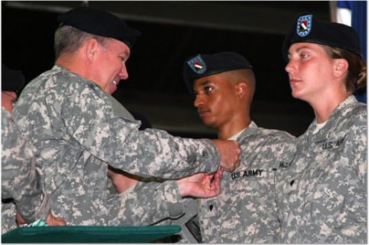 Brig. Gen. Michael Swezey presents Soldiers of the 104th MP Battalion with awards