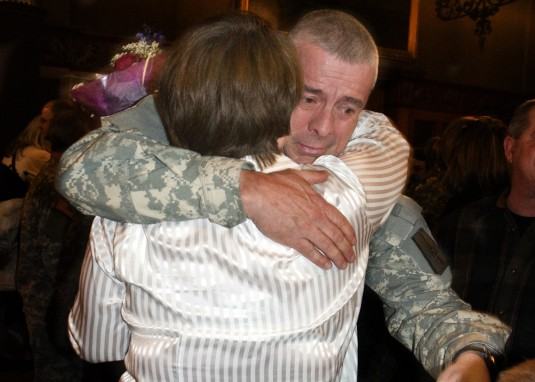 Cmd. Sgt. Maj. Randy Ross farewells family at his unit sendoff ceremony.