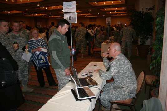 Troops learn about military and veterans benefits at reintegration event.