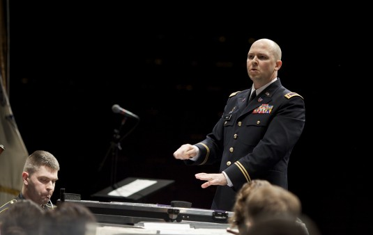Chief Warrant Officer Mark Kimes guest conducts the Army Field Band in Albany March 7