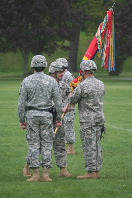 Brig. Gen. Wickstrom passes the division colors to Cmd. Sgt. Maj. Robert Jenks