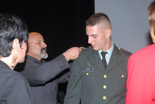 2LT Anthony J Fasano is pinned by relatives during his commissioning ceremony.