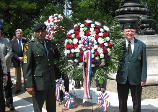 New York Army National Guard Command Sgt. Maj. Jorge Vasquez from the Guard's 1st Battalion, 69th Infantry and Mr. Thomas Fitzsimmons of the 69th Veteran's Association place a memorial wreath