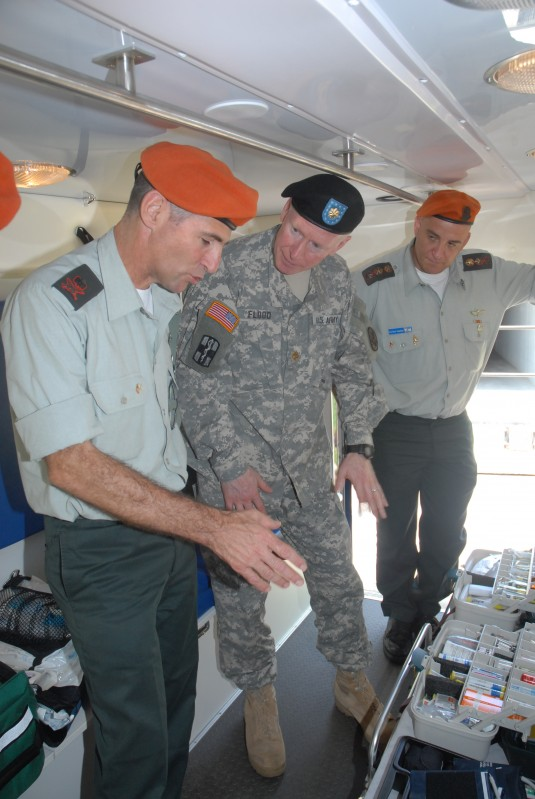Maj. Charles Flood of the 24th Civil Support Team discusses capabilities with Maj. Gen. Yair Golan