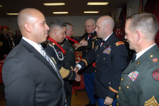 Lt. Col. Mike Hoblin presents the Ancient Order of Saint Barbara to 1-258th Field Artillery Soldiers