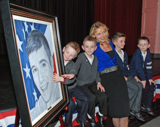Barbara Allen with her four sons and the portrait of her husband, 1st Lt. Lou Allen.