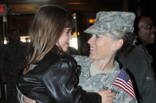 New York Army National Guard Major Tanya Pennella greats her daughter Angelina Pennella after returning from 10 months service in Iraq