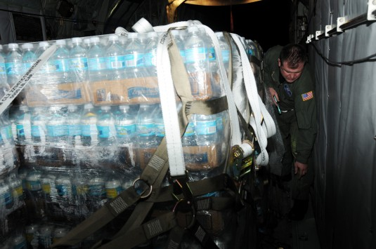 NewYork Air National Guard loadmaster secures cargo bound for Haiti