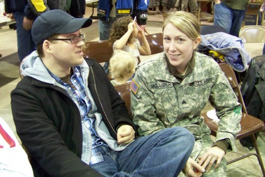 New York Army National Guard Soldier and her boyfriend during deployment ceremony