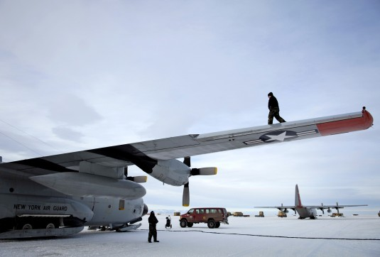109th Airlift Wing maintenance crews conducts a post-flight check of an LC-130 Hercules on the ice runway near McMurdo Station, Antarctica.