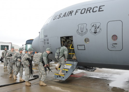 Soldiers boarding C-130