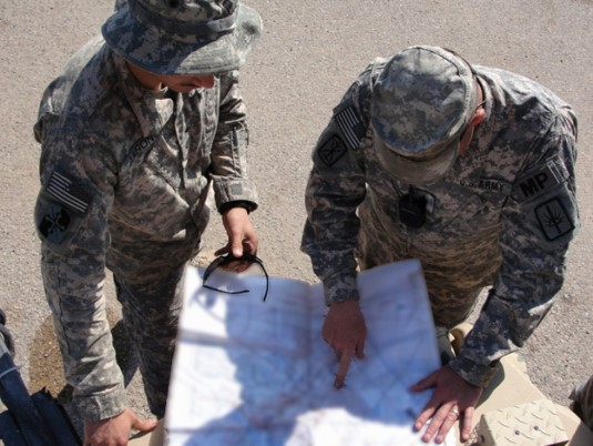 Soldiers examine a map