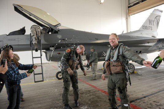 Lt. Col. D.Scott Brenton gets Champaign wet down following his final F-16 flight
