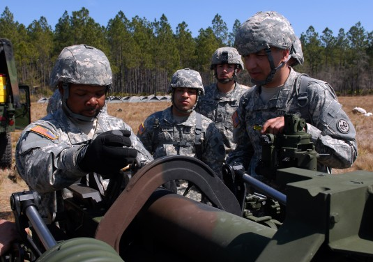 National Guard Soldiers Deploying Cannon