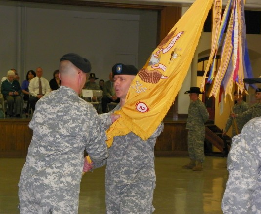 Change of command ceremony, passing flag