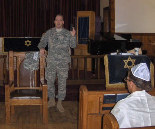 1st Lt. Mark Getman delivers a sermon during Jewish Services March 28
