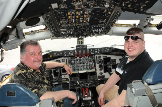 Robert Burns (on left) and his son Jared Burns inspect the cockpit of an Air Force KC-135