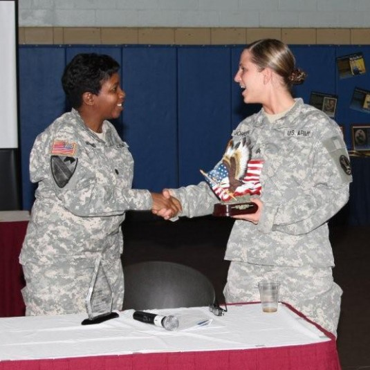 Lt. Col. Kelly F. Hilland, left, Director of Family Programs for Joint Force Headquarters, New York Army National Guard, congratulates Army Sgt. Sarah Johnson for her service