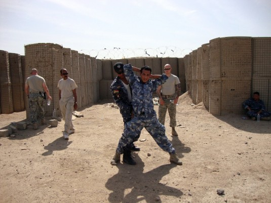 Iraq police officers practicing hand-to-hand combat.