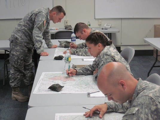 Soldiers studying maps.