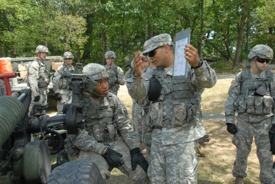 Soldiers giving instruction to West Point Cadet