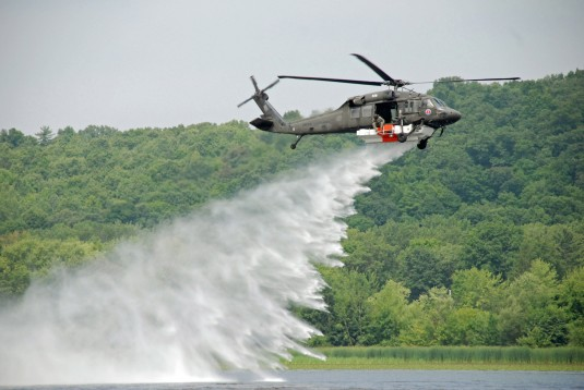 Fire hawk helicopter dumping water