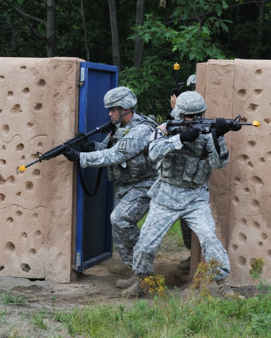 EOD Battalion Soldiers practice combat operations in urban areas during training.