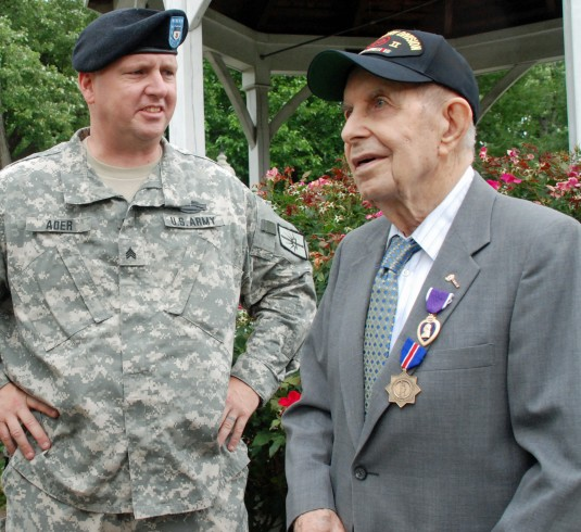 Cohoes native John Sidure displays his Purple Heart received for his wounds received in WWII