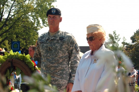 Maj. Gen. Patrick Murphy dedicates a memorial wreath with Gold Star Mother Mary Burgen