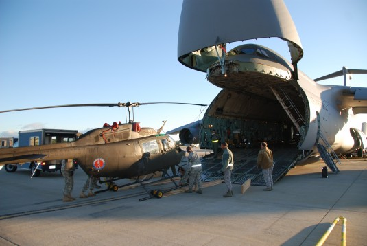 OH-58 helicopter being unloaded from New York Air National Guard C-5