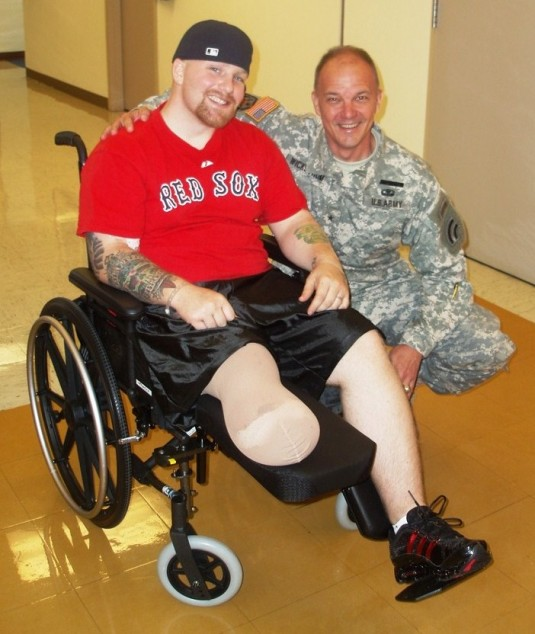 Brig. Gen. Steven Wickstrom greets Spc. Ryan Braman at Walter Reed Army Medical Center