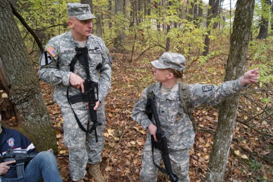 New York Army National Guard Staff Sgt. Adam Barber trains with SUNY Adirondack ROTC Cadet Tracy Pauquette
