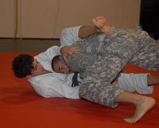 Soldier practicing hand-to-hand combat moves with Jiu-Jitsu instructor.
