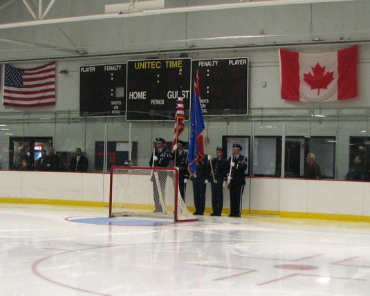 Color Guard behind hockey net at Rome, NY Hockey game