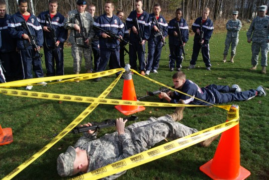 Non-commissioned officer demonstrating obstacle clearance.