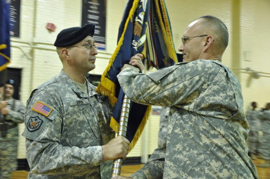 Major James Gonyo II accepts the colors of the 69th Infantry from Col. Geoffrey Slack on Saturday Nov. 20.