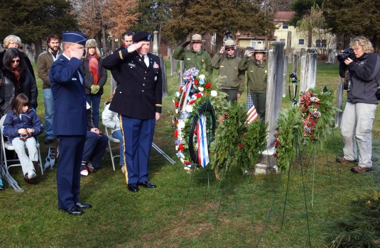 National Guard officers saluting Pres. Martin Van Buren's gravesite.