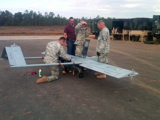Soldiers working on UAV.