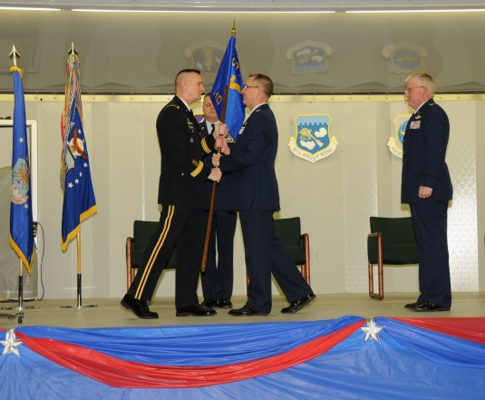 Major General Patrick Murphy passes flag to Col. Jim McCready the new commander of the 107th Airlift Wing.