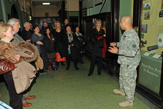 Army National Guard sergeant speaking to visitors to Lexington Avenue Armory