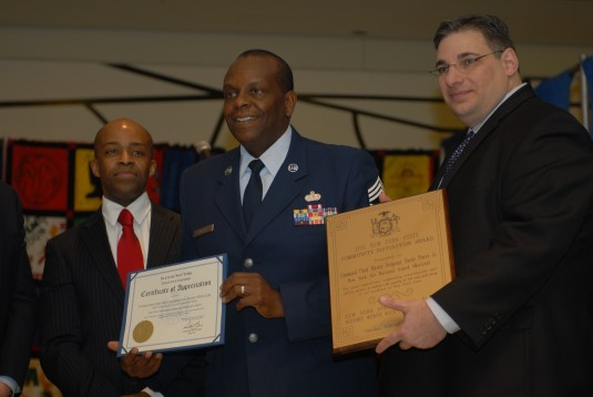 Command Chief Master Sgt. Hardy Pierce receives award.
