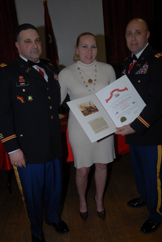 Janet Marie Conte (center) receives the Artillery Order of Molly Pitcher from Lt. Col. Michael Hoblin, commander of the 1-258 Field Artillery