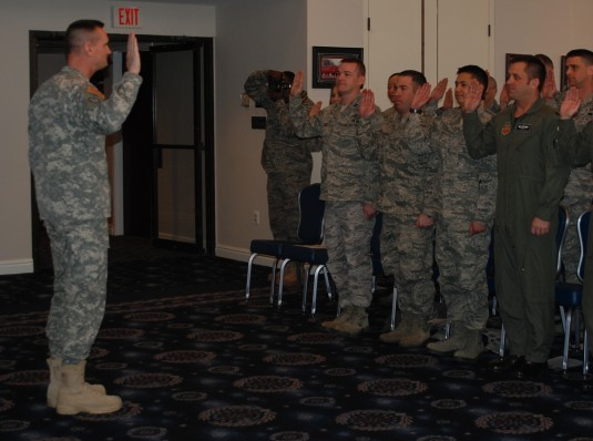 Major General Patrick Murphy administers oath of enlistment.