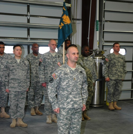 Major Jody Lupo in front of Soldiers and Airmen.